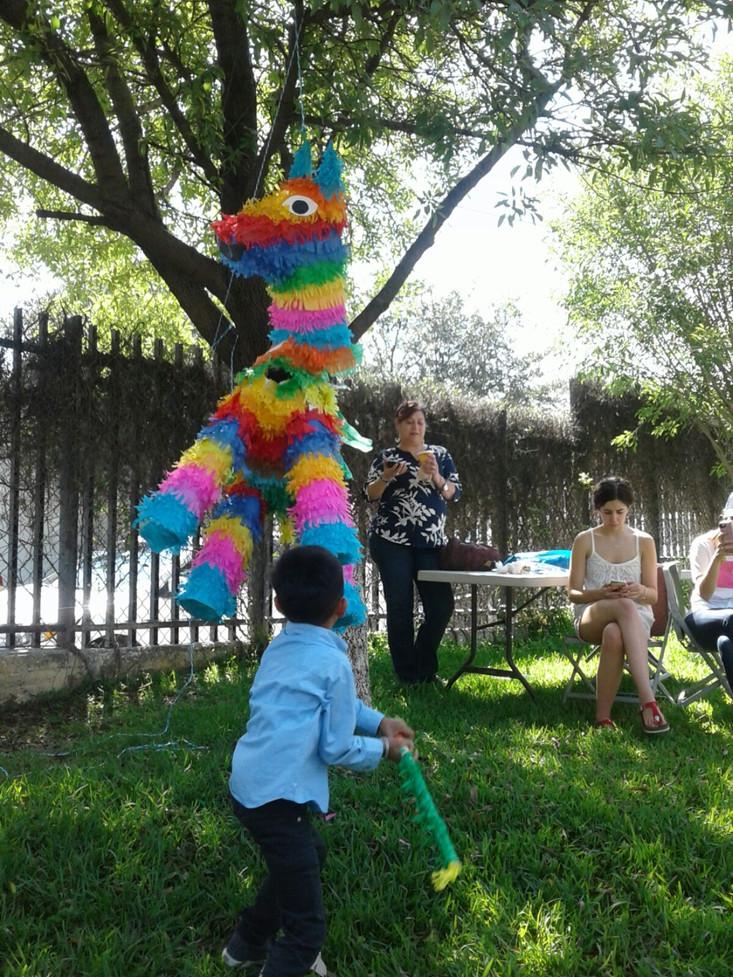 Hitting the piñata!