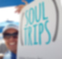 woman holding a sign with the logo of soul trips