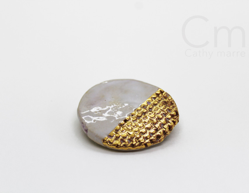 Broche golden Scales