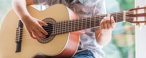 guy-playing-acoustic-guitar-header.jpg
