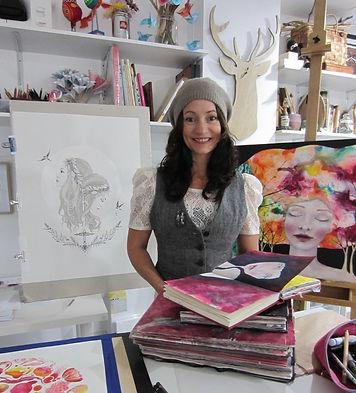Helen standing in her studio smiling