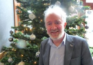 Malcolm Noonan stands by Christmas tree 2018