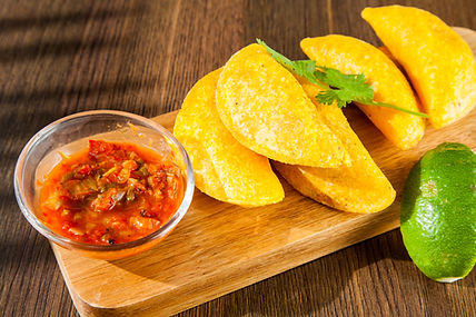 Colombian empanada with spicy sauce