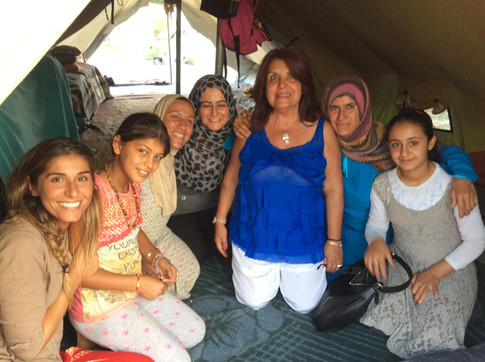 Sarah and Latifa are invited for tea in a Syrian camp