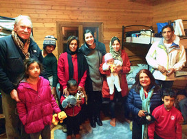 Alex, Latifa and Colin with an Afghan family grieving for their lost grandmother.
