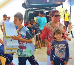 Everyone helps in the Yazidi camp