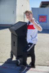High school student at Encore film school training facility moving equipment