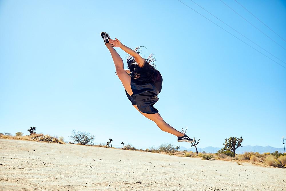 Encore High School dancer Gabby Rosales leaps in the high desert