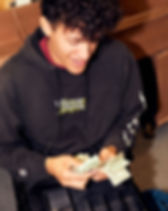 male teenager counting money in ASB high school