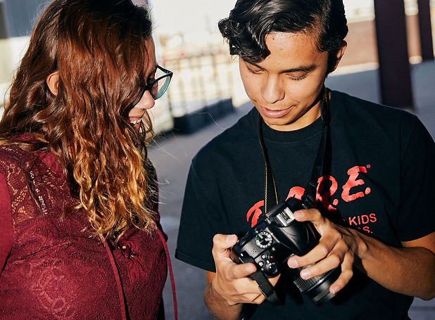 photography high school two students helping each other with camera