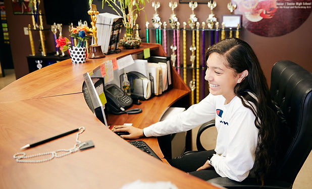 CTE high school student studies office positions as an intern receptionist