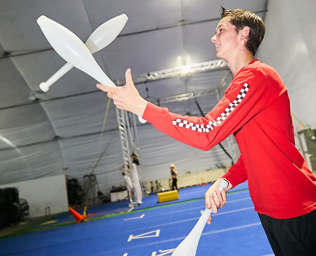 circus high school student juggles clubs at encore high school training facility