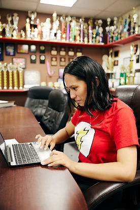 High school female student on a laptop computer in a trophy room