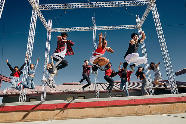 Hip Hop dance school students perform on the outside stage at encore high school