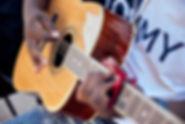 high school music school student plays acoustic guitar