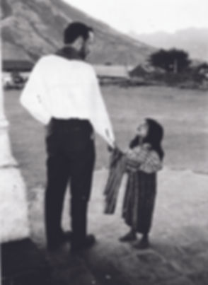 Fr Rother and little girl_0920.jpg