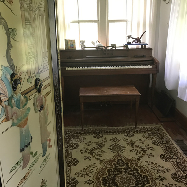 enclosed porch area with out of tune piano for cagean experiments