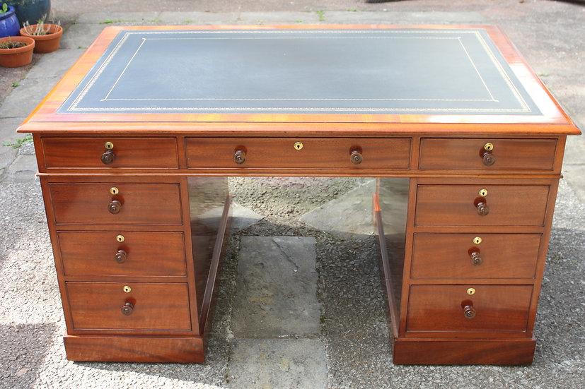 A George IV period mahogany 18-drawer pedestal partners desk.