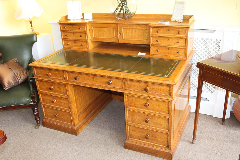 A Victorian oak pedestal desk by James Lamb