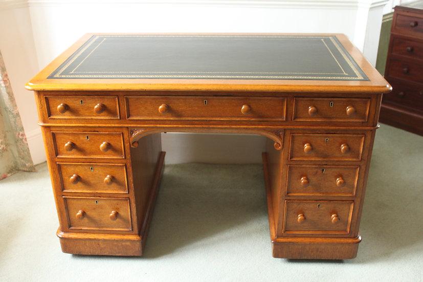 Victorian oak nine drawer pedestal desk by Edwards & Roberts
