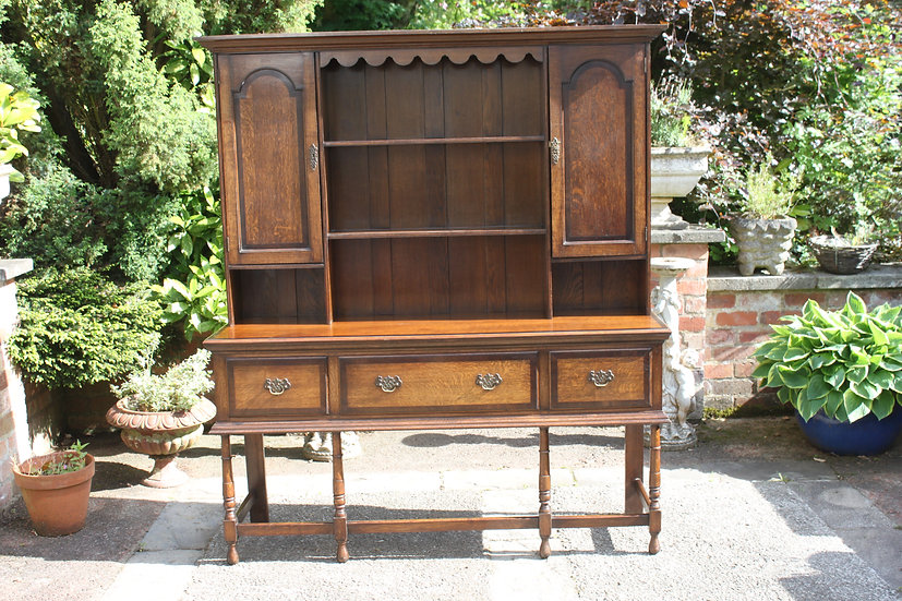 A 19th century oak and mahogany crossbanded dresse