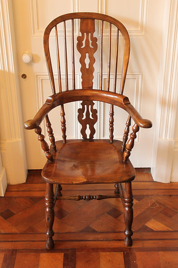 A 19th century north country ash and elm broadarm Windsor armchair
