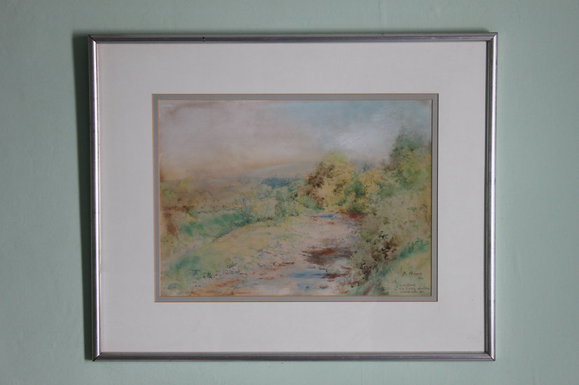 A framed watercolour by M A Holmes.