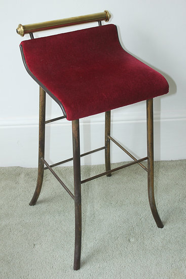 A 19th century brass and steel music stool
