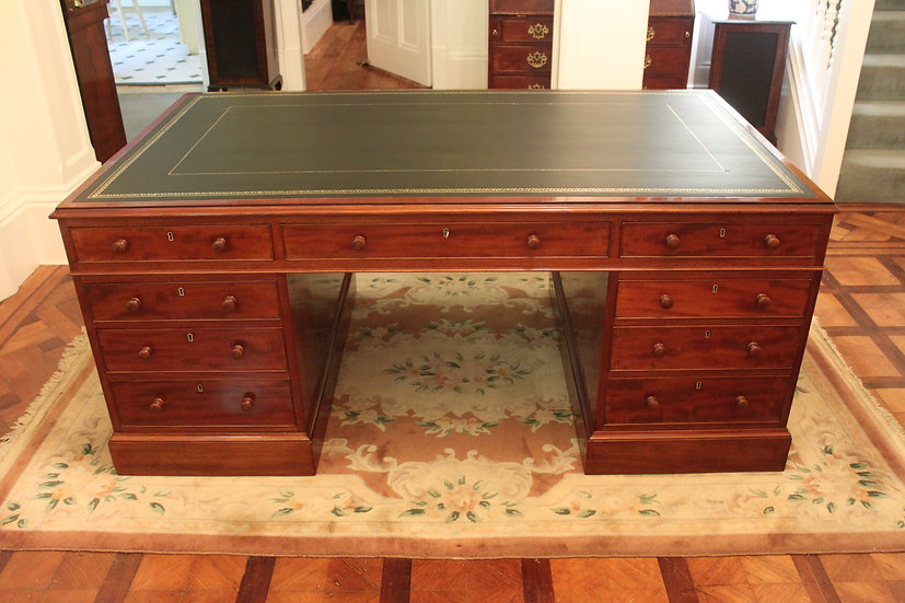 A fine George IV early 19th century 18 drawer mahogany partners desk