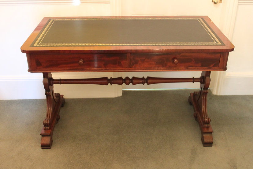 An early 19th century mahogany two drawer writing table by Gillows of Lancaster.
