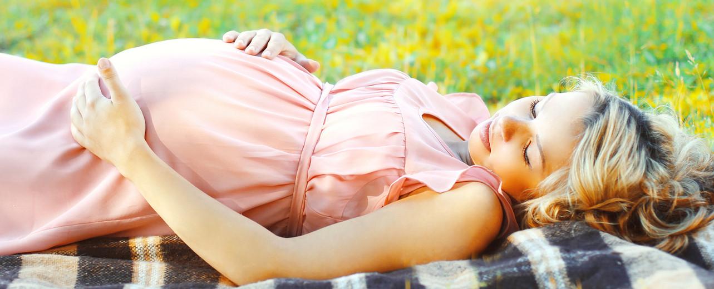 pretty pregnant woman lying resting on g
