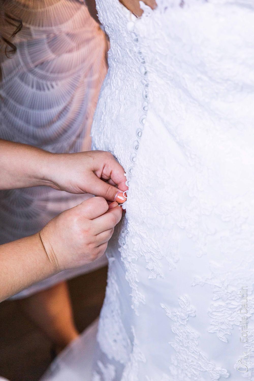 photographie boutonnage robe mariée