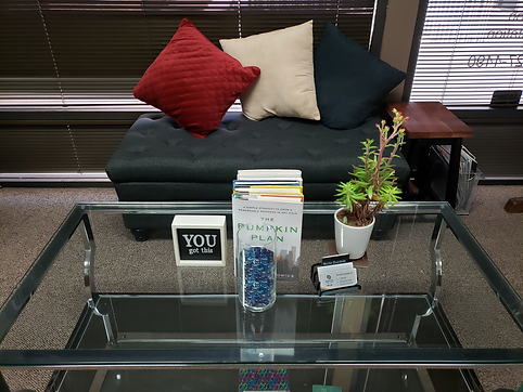 SMG Business Services Office_Couch, Coffee Table, The Pumpkin Plan Book, You Got This Frame, Plant