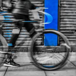 Walking his bicycle.jpg