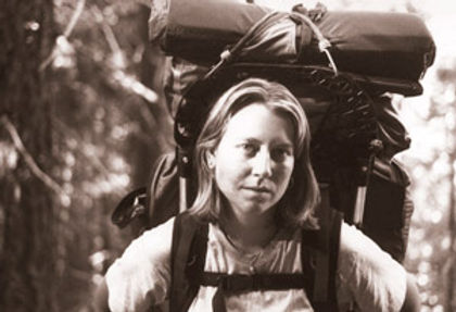 Cheryl Strayed wearing her oversized pack along the PCT.