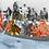 Collage de hombres y peces en una canoa