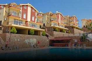 Kuşadası Kadınlar Denizi Mahallesi'nde Deniz Manzaralı Eşyalı Satılık 3+1 Villa