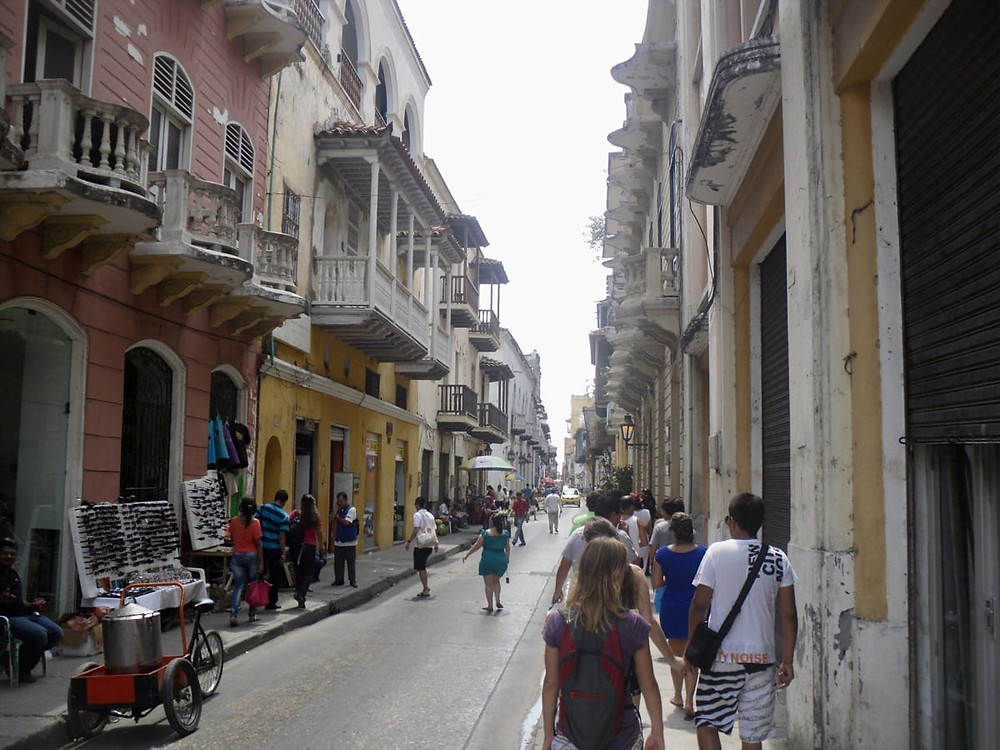 Bronnie walking along a street in historical Cartagena, Colombia