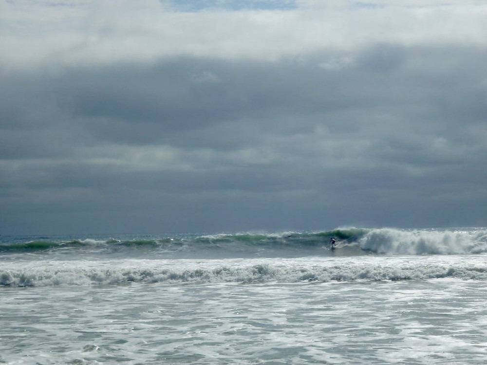 Ollie surfing in Ayampe Ecaudor