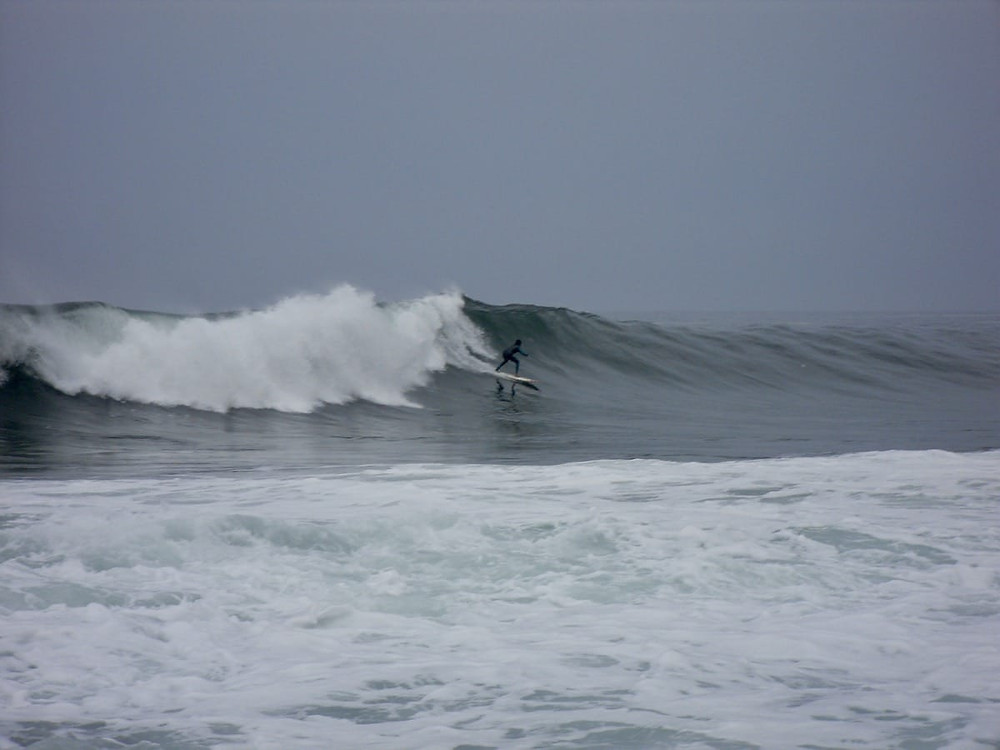 Picolini surfing a bomb at Piedras Negras in Peru