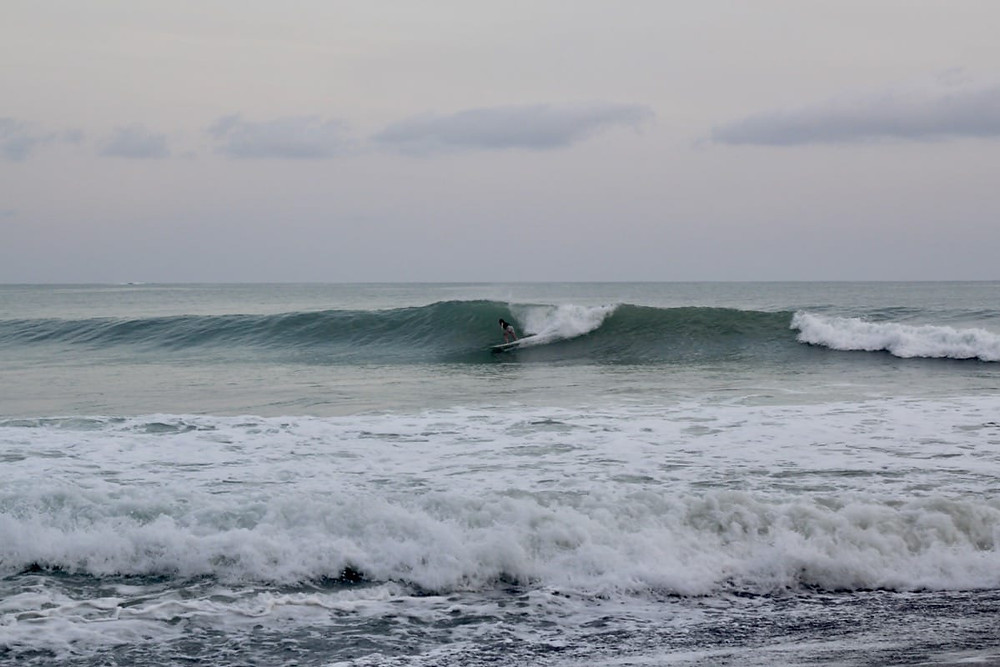 Bronnie surfing Cuatro Once at Cambutal in Panama