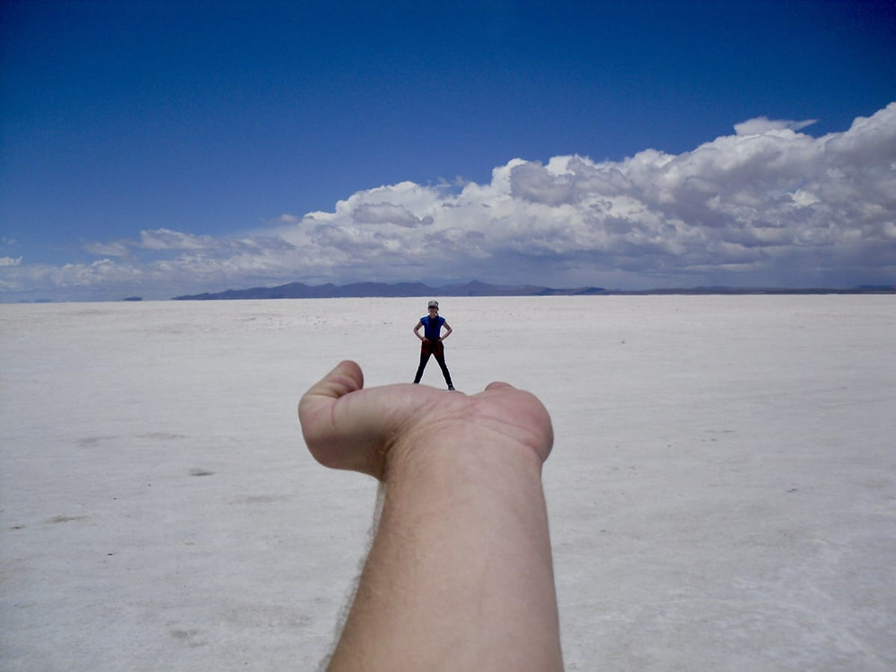 Mini Bronnie on Ollie's hand at the salt lakes in Bolivia