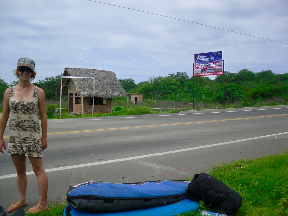 Bronnie hitchhiking through Ecuador with surfboards in tow