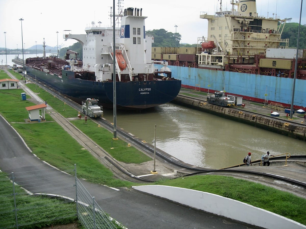 Two ships passing through the last lock at the Panama Canal