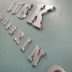 Clear 3D lettering with brushed alloy finish