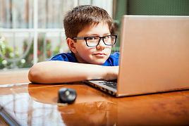 bigstock-Kid-Doing-Homework-On-A-Laptop-