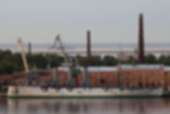 This is a picture of the ship Abpopa, docked infront of a red brick building.