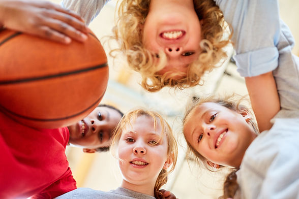 Canva - Group of Kids Forms a Basketball