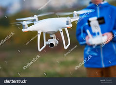 stock-photo-young-man-operating-of-flyin