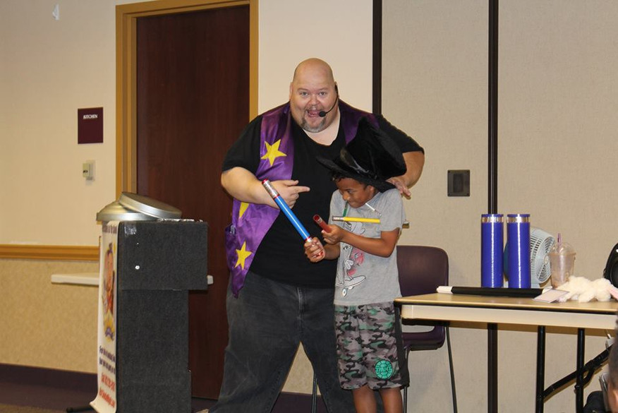 Doodad the Magician got a little help from the audience during his magic show at the Aliante Library!